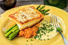 Halibut Filet with Asparagus and Sweet Potatoes Stock Image