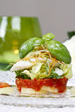 Halibut with fresh vegetables, green candle in the background Stock Photos