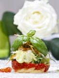 Halibut with fresh vegetables, white rose in the background Royalty Free Stock Photos