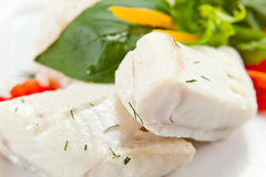 Halibut with greens Royalty Free Stock Image