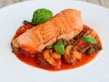Halibut with mushrooms and mint in cherry tomato sauce Stock Photo
