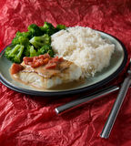 Halibut with rice and veggies. Seared halibut with broccoli, lime flavored white rice and a creamy heirloom tomato sauce Royalty Free Stock Photos
