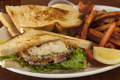 Halibut sandwich with sweet potato fries Stock Photo