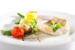 Halibut Steak and Vegetables Stock Photos