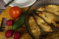 Halibut steaks baked in a glass dish