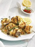 Halibut and vegetable brochettes, bed of quinoa Stock Photography