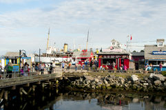 HALIFAX, CANADA - August 13, 2016:. The Halifax Waterfront Boardwalk is a public footpath and a tourist destination popular for its shops and restaurants Stock Photos