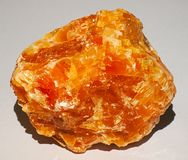 Halite crystal gem mineral stone orange yellow shiny brilliant. Halite commonly known as rock salt, is a type of salt, the mineral natural form of sodium royalty free stock photo