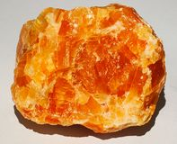 Halite crystal gem mineral stone orange yellow shiny brilliant. Halite commonly known as rock salt, is a type of salt, the mineral natural form of sodium stock images