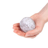 The halite salt ball. Woman's hand holding a halite salt ball royalty free stock photo