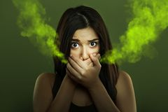 Halitosis concept of woman with bad breath stock images