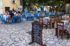 Halki, Emborios village - Traditional greek tavern restaurant, tables and chairs.Dodecanese Islands, Greece stock photo