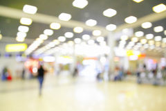 Hall in airport out of focus Stock Photo