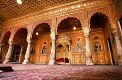 Hall with arches in gold patterns in India Royalty Free Stock Photography