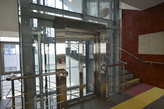Hall with atransparent glass elevator Stock Photo