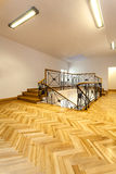 Hall. Bright hall with wooden parquet and elegant staircase Royalty Free Stock Photography