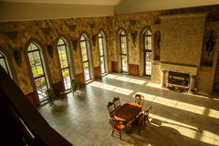 Hall of castle palace with large windows. Royalty Free Stock Photography