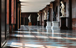 Hall in a castle with statues Stock Photo