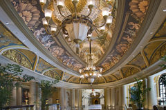 Hall with ceiling drawings and two chandeliers royalty free stock photos