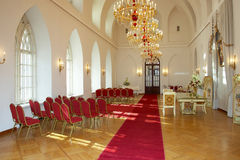 Hall of celebrations at the palace. Celebrations in the palace hall with red carpet track Royalty Free Stock Photo