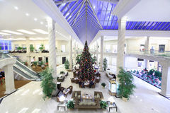 Hall with Christmas tree in Crocus City Mall. MOSCOW - DECEMBER 15: Hall with Christmas tree in Crocus City Mall on December 15, 2011 in Moscow, Russia. Shopping Stock Images