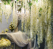 Hall decorated with flowers. Hall decorated with hanging branches of flowers and lights Royalty Free Stock Photos