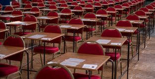 Hall with desks and tables, ready to be used for examination purposes. stock photo