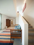 Hall with divan and striped rug. Interior of a modern house, hall with divan and striped rug royalty free stock images