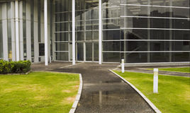 Hall entrance. Modern building hall entrance from green meadow environment Stock Photography