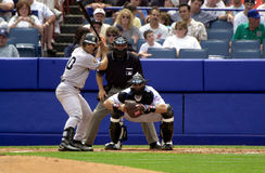 Hall of Fame Catchers. Battle of two Hall of Fame catcher, Jorge Posada of the New York Yankees  bats with Hall of Fame catcher Mike Piazza behind home plate Royalty Free Stock Images