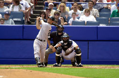 Hall of Fame Catchers. Battle of two Hall of Fame catcher, Jorge Posada of the New York Yankees  bats with Hall of Fame catcher Mike Piazza behind home plate Stock Photos