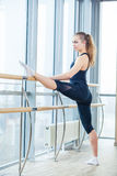 In the hall girl doing stretching near Barre Royalty Free Stock Image