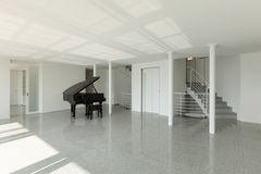 Hall with grand piano Stock Images