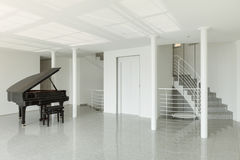 Hall with grand piano Stock Photos