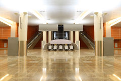 Hall with granite floor, columns and escalators. Big modern hall with granite floor, columns and two escalators in airport, general view stock image