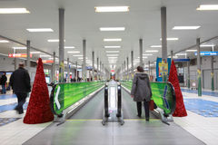 Hall with horizontal escalator at CDG airport. PARIS - DECEMBER 29: Hall with horizontal escalator at the CDG airport, decorated with Christmas trees, December Stock Photo