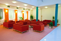 Hall in hotel with red  armchair Royalty Free Stock Photography