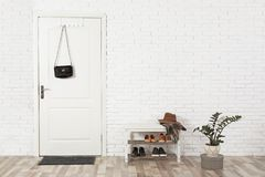 Hall interior with brick wall and white door. Hall interior with brick wall and white wooden door royalty free stock image