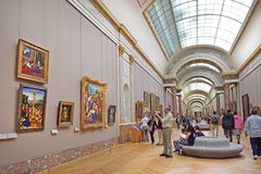 Hall of italian painting, Louvre Museum in Paris. PARIS, FRANCE -23 may 2018: tourists visiting the world`s masterpieces in the hall of italian painting, Louvre stock image
