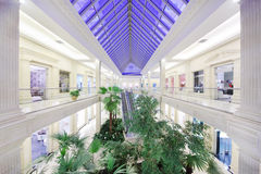 Hall with many plants in Crocus City Mall Stock Photos