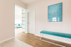 Hall with map. Simple hall with a blue map and bench and living room interior in the background royalty free stock photography