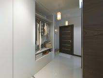 Hall med en korridor i modern stil med en garderob och ett a Arkivfoton