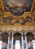 Hall of Mirrors painted ceiling at Versailles Palace, France. Versailles, France - 10 August 2014 : Hall of Mirrors painted ceiling at Versailles Palace ( royalty free stock images