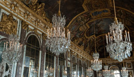 Hall of Mirrors in Versailles. The Hall of Mirrors is the central gallery of the Palace of Versailles in Versailles, France and is renowned as being one of the Stock Photos