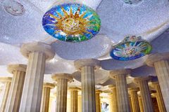 Hall with mosaic, Guell Park, Barcelona, Spain. Hall with mosaic sun at ceiling, at Guell Park, Barcelona, Spain royalty free stock photos