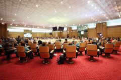 Hall with people at round table Royalty Free Stock Photography