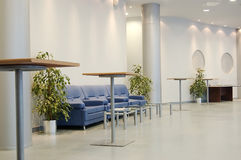 Hall in a public building. Hall with little tables and armchairs for rest Stock Photos