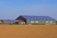 Hall with solar roof. Agricultural halle with solar roof Royalty Free Stock Image