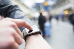In hall station a man using his smartwatch. Close-up hands Royalty Free Stock Photo