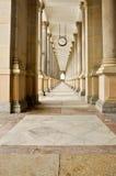Hall of stone pillars and marble floor Stock Photos